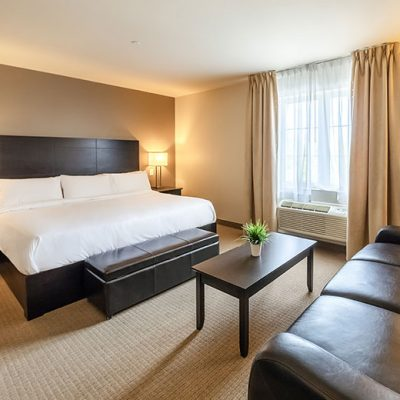 King bed + Sofa bed | Your Imperia Hotel & Suites in Saint-Eustache